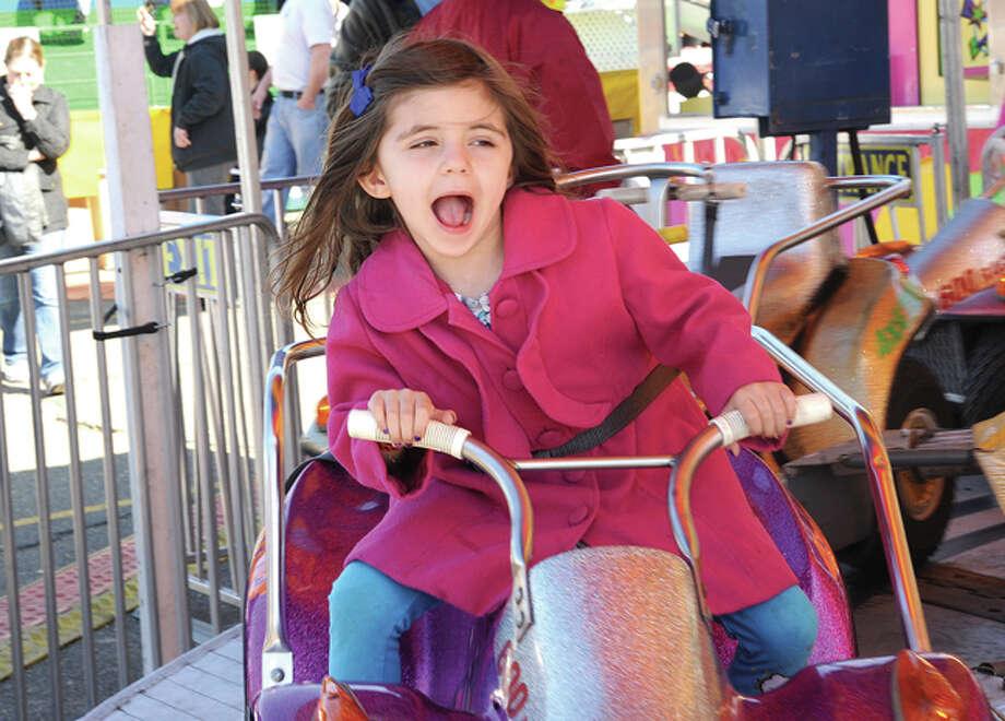 Gabriella Casatelli 5 on the car ride Sunday at Miller-Driscoll School's first Annual ÒSpring Spectacular CarnivalÓ photo/Matthew Vinci
