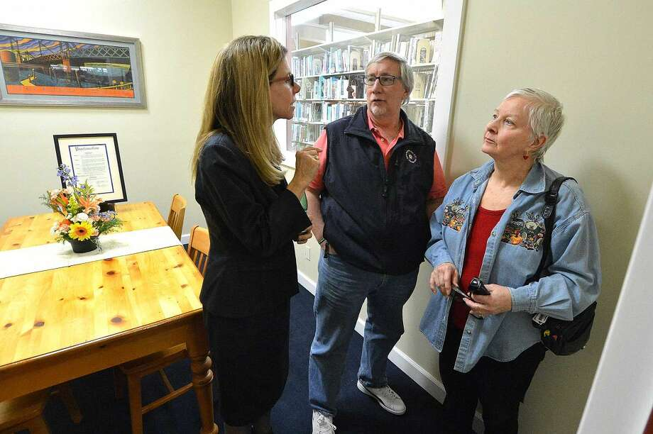 Hour Photo/Alex von Kleydorff Norwalk Public Library Director Christine Bradley talks with Rick McQuade and Marcia Powell in the newly opened Judy's Room, dedicated to Judy Rivas at The Norwalk Library