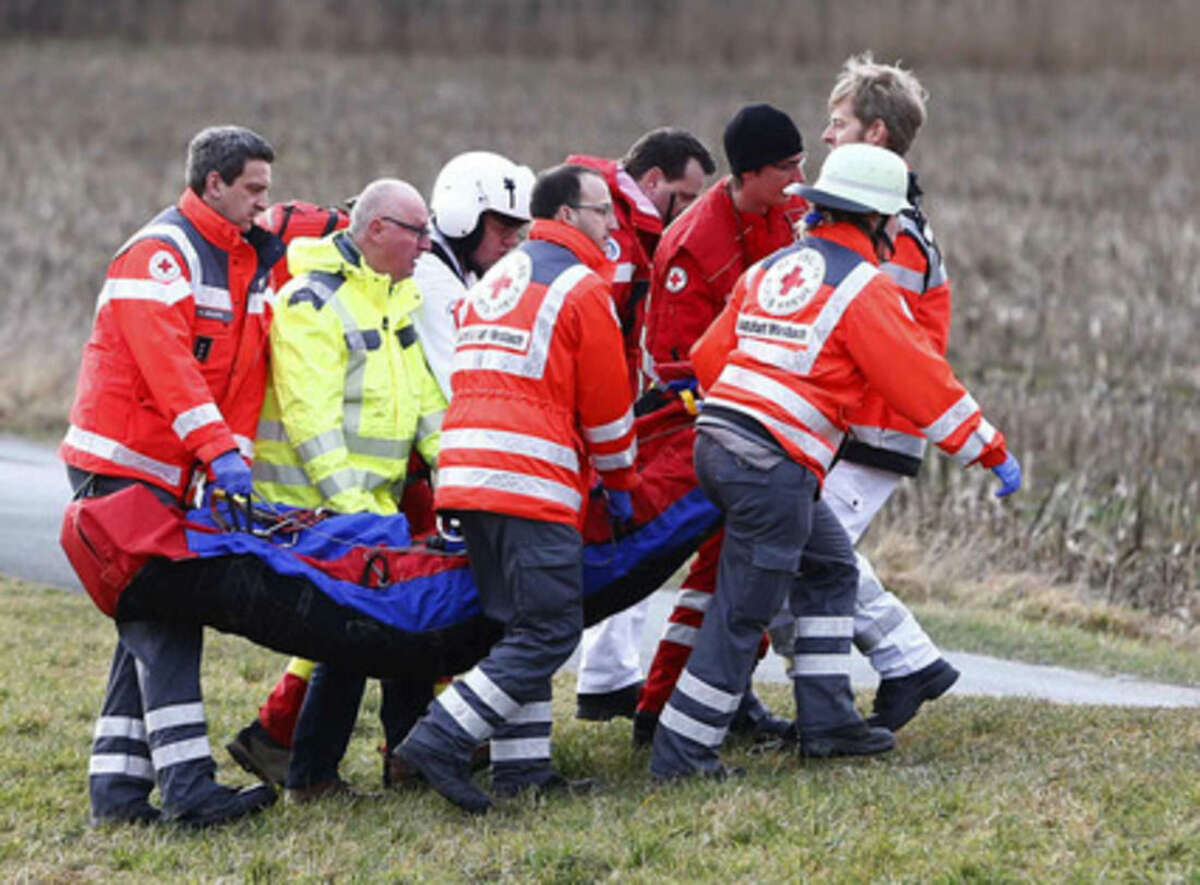 Rescue personnel carry an injured person near the site where two trains collided head-on near Bad Aibling, southern Germany, Tuesday, Feb. 9, 2016. Several people have been killed and dozens were injured. (AP Photo/Matthias Schrader)