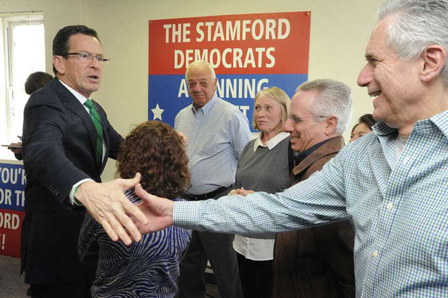 Connecticut Governor Dannel Malloy greets Mike Yantorno Sunday at the Malloy campaign open house in Stamford. Hour photo/Matthew Vinci