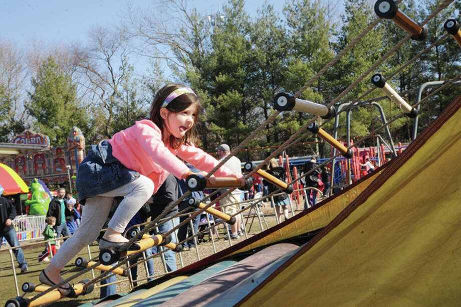 Ashley O'Donnell 6, tries to stay on the ropes at Miller-Driscoll School's first Annual ÒSpring Spectacular CarnivalÓ photo/Matthew Vinci