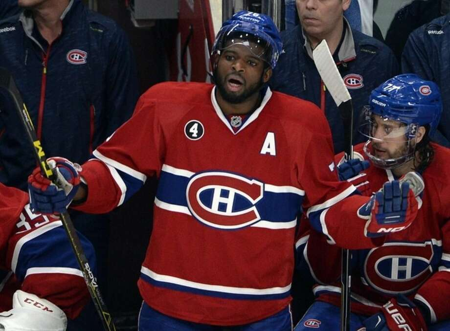 In this Wednesday, April 15, 2015, photo, Montreal Canadiens defenseman P.K. Subban (76) argues after receiving a game misconduct during the second period of Game 1 of an NHL first round playoff hockey match against the Ottawa Senators in Montreal. Lots of scoring and wild action took a back seat Wednesday night to a slash that could lead to a suspension for Canadiens defenseman P.K. Subban. (Ryan Remiorz/The Canadian Press via AP)