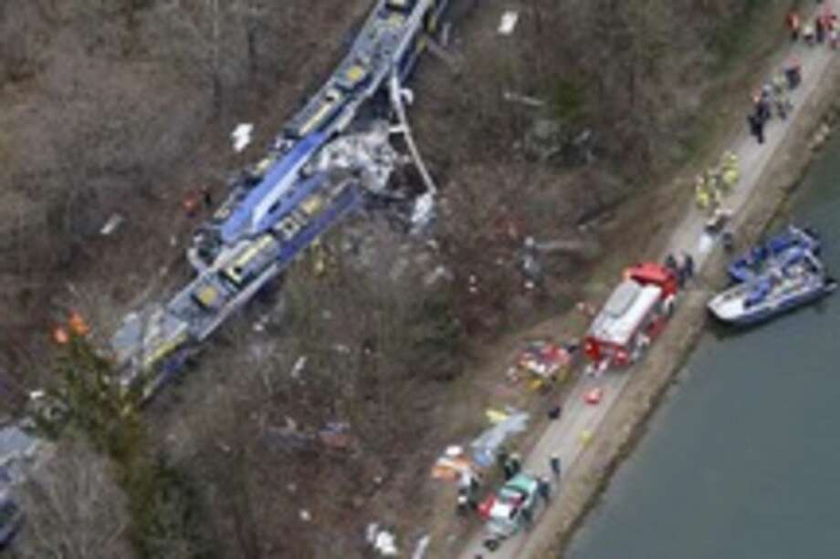 Aerial view of rescue teams at the site where two trains collided head-on near Bad Aibling, Germany, Tuesday, Feb. 9, 2016. Several people have been killed and dozens were injured. (AP Photo/Matthias Schrader)