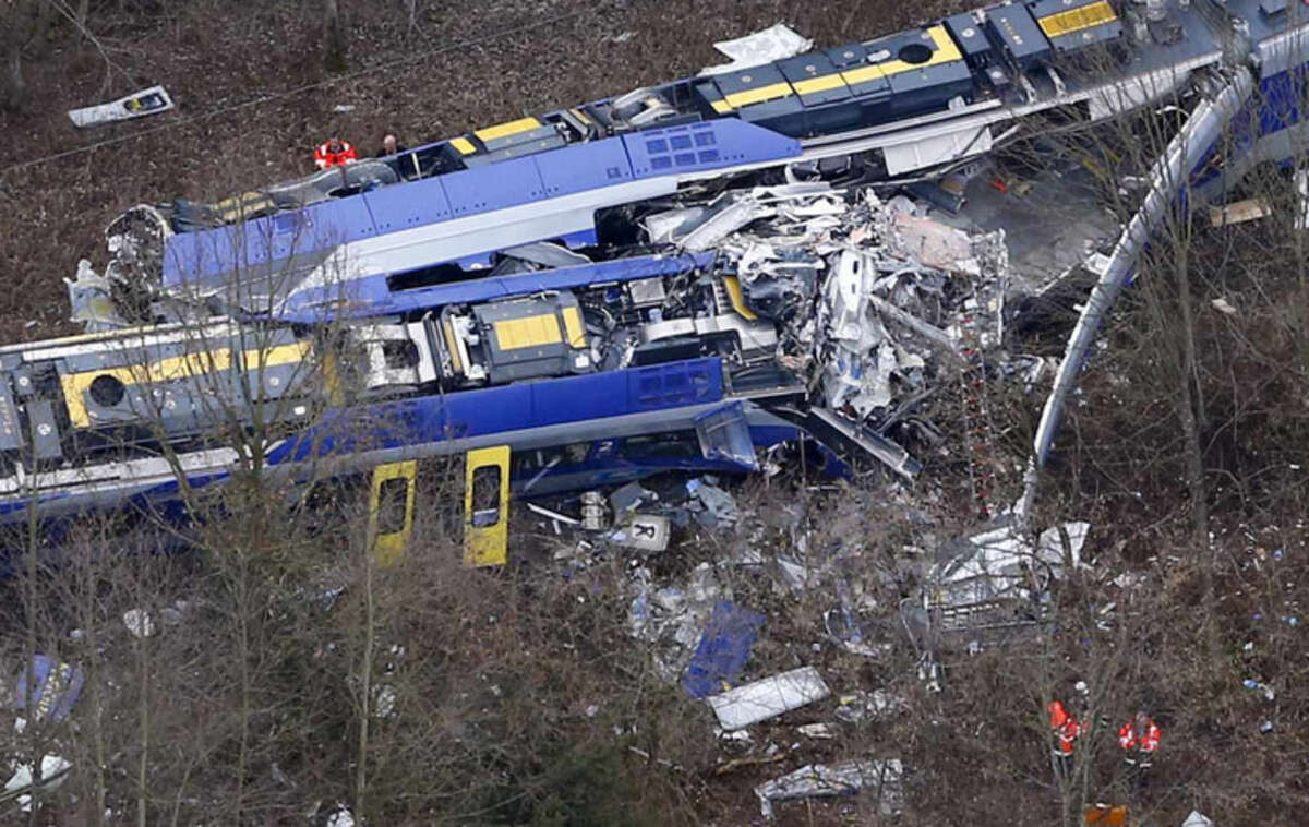 RECROPED VERSION - Aerial view of rescue teams at the site where two trains collided head-on near Bad Aibling, Germany, Tuesday, Feb. 9, 2016. Several people have been killed and dozens were injured. (AP Photo/Matthias Schrader)