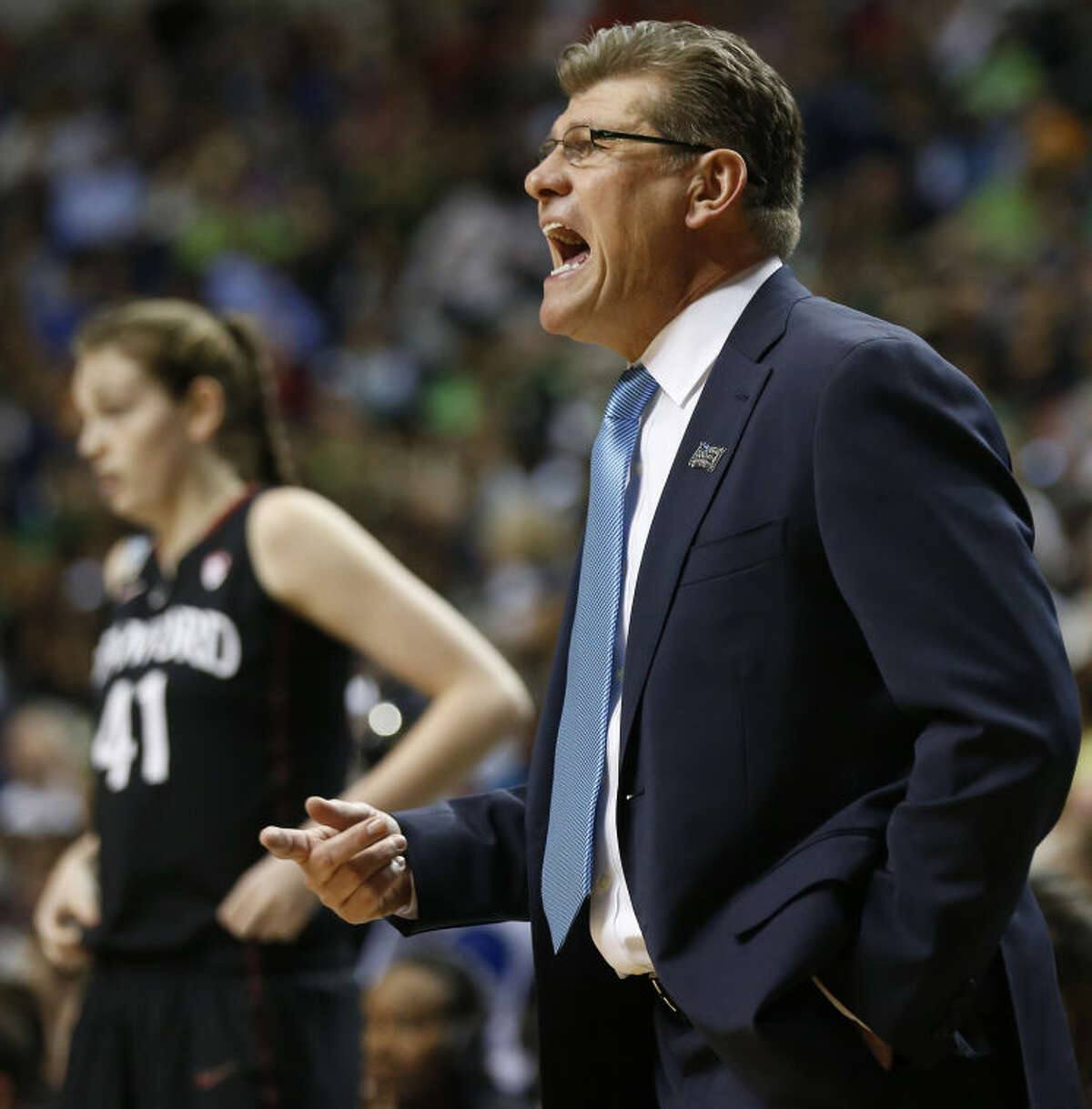 Connecticut head coach Geno Auriemma speaks to players against Stanford during the first half of the semifinal game in the Final Four of the NCAA women's college basketball tournament, Sunday, April 6, 2014, in Nashville, Tenn. (AP Photo/John Bazemore)