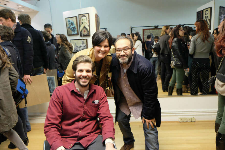 A pole vaulting accident left Wilton native B.D. White paralyzed. Despite his injury, the budding artist is shaking up the New York City art scene. Here White poses with two New York art buyers during a recent showcase.