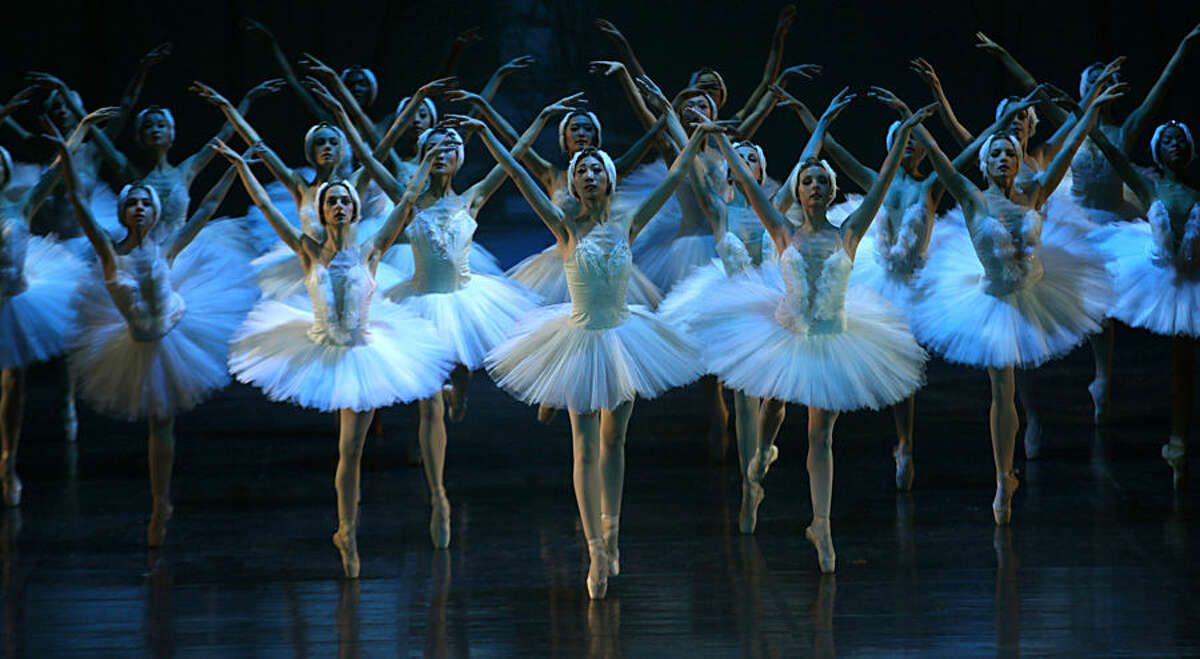 """CAPTION CORRECTS THE YEAR - Dancers of the Joburg Ballet and the Liaoning Ballet of China company take part in a final dress rehearsal, in Johannesburg, South Africa, Thursday, April 16, 2015 ahead of a two week run of performances of """"Swan Lake"""" which gets under way at the Joburg Theater Friday. (AP Photo/Denis Farrell)"""