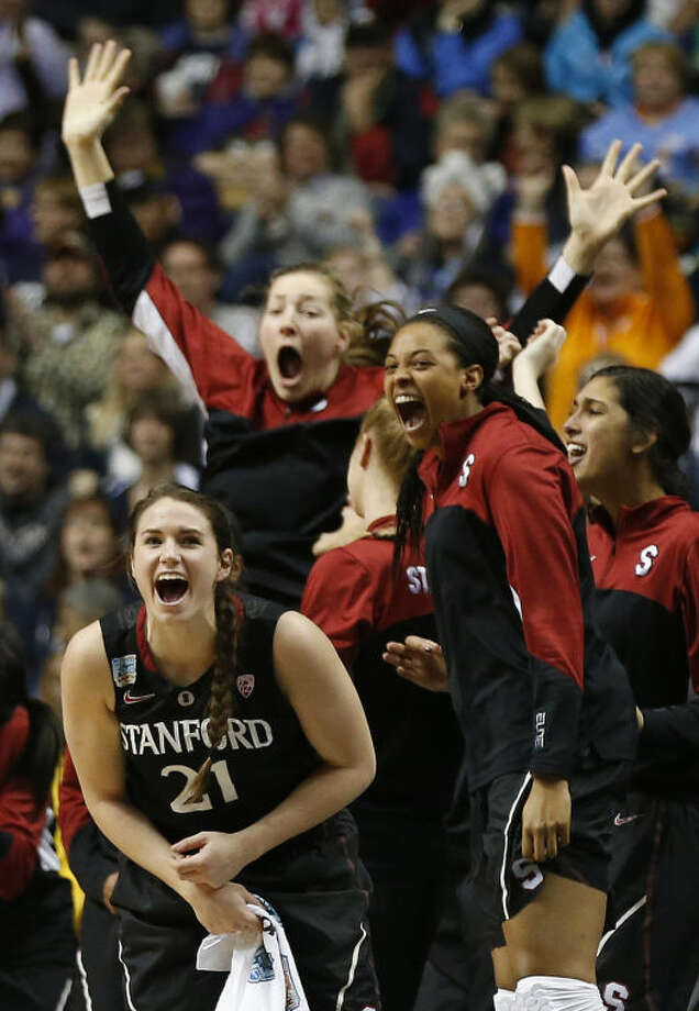 Stanford players celebrate a three-point shot against Connecticut during the first half of the semifinal game in the Final Four of the NCAA women's college basketball tournament, Sunday, April 6, 2014, in Nashville, Tenn. (AP Photo/John Bazemore)