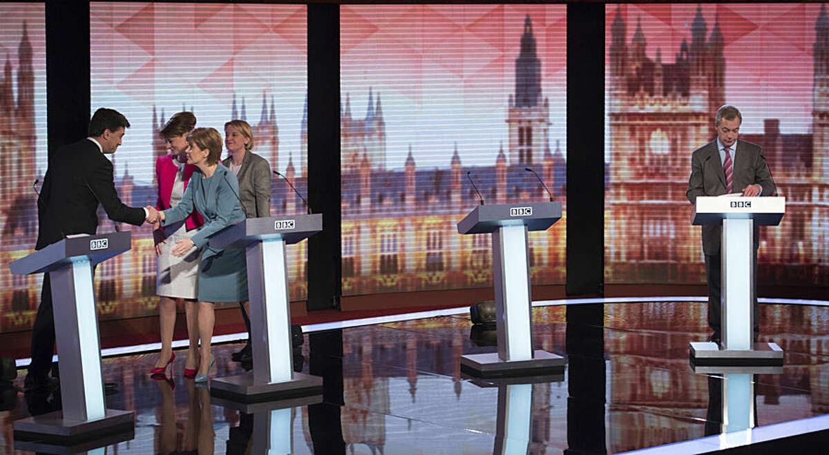 From left, Labour Party leader Ed Miliband greets Plaid Cymru Party leader Leanne Wood, Scottish National Party leader Nicola Sturgeon, Green Party leader Natalie Bennett, as UKIP leader Nigel Farage stands at his lectern after a British election debate broadcast on television at Central Hall Westminster, London, Thursday, April 16, 2015. Britain will vote in a general election on May 7. (AP Photo/Stefan Rousseau, Pool)