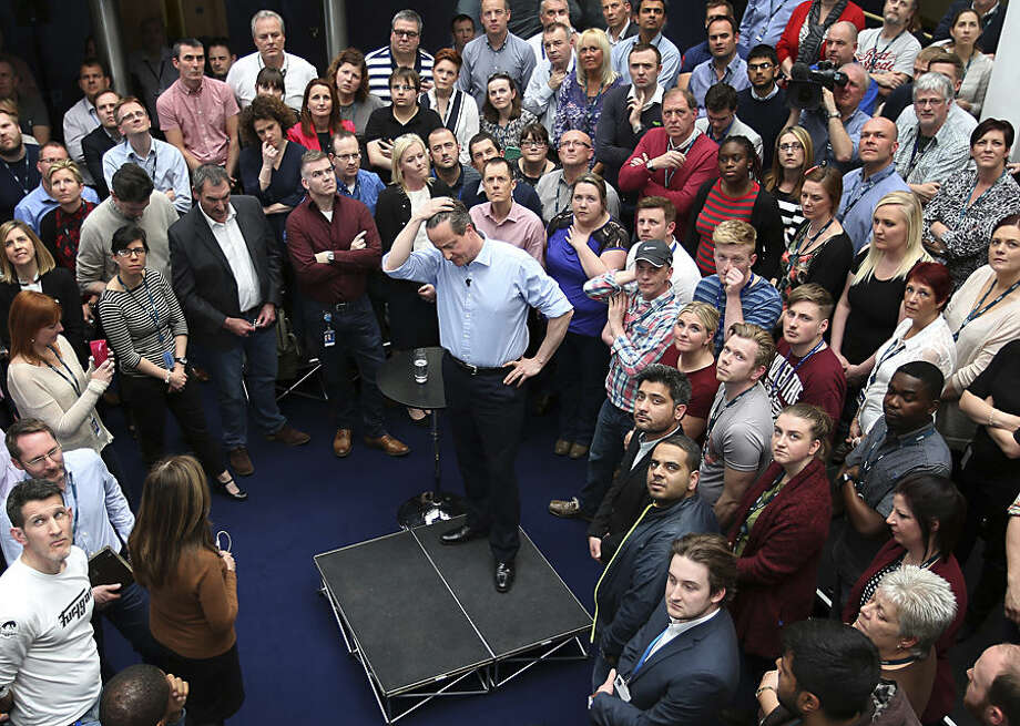 Britain's Prime Minister David Cameron reacts as he answers questions from 02 employees on Thursday April 16, 2015, in Leeds, England, during an election campaign stop. Conservative party leader Cameron is touring the country ahead of the upcoming General Election on May 7. (Peter Macdiarmid/Pool photo via AP)