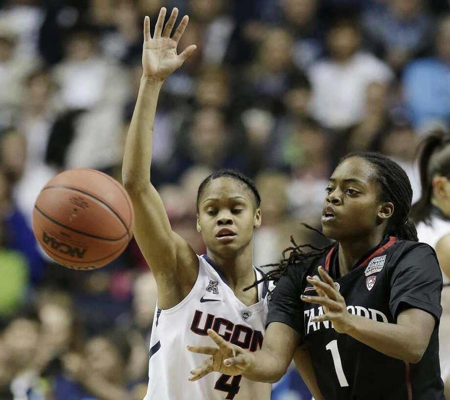 Stanford guard Lili Thompson (1) passes the ball against Connecticut guard Moriah Jefferson (4) during the first half of the semifinal game in the Final Four of the NCAA women's college basketball tournament, Sunday, April 6, 2014, in Nashville, Tenn. (AP Photo/Mark Humphrey)