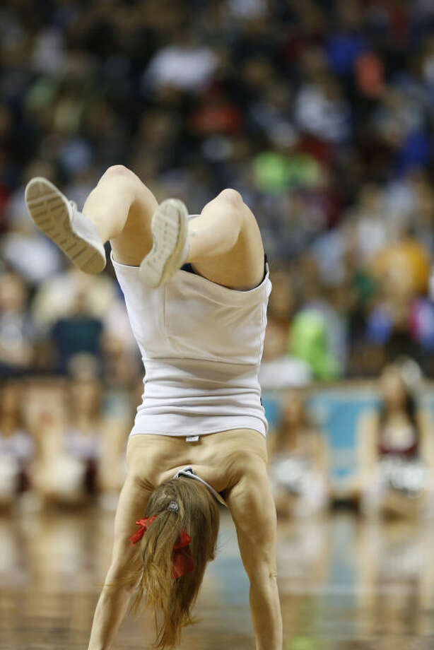 Connecticut cheerleaders perform against Stanford during the first half of the semifinal game in the Final Four of the NCAA women's college basketball tournament, Sunday, April 6, 2014, in Nashville, Tenn. (AP Photo/John Bazemore)