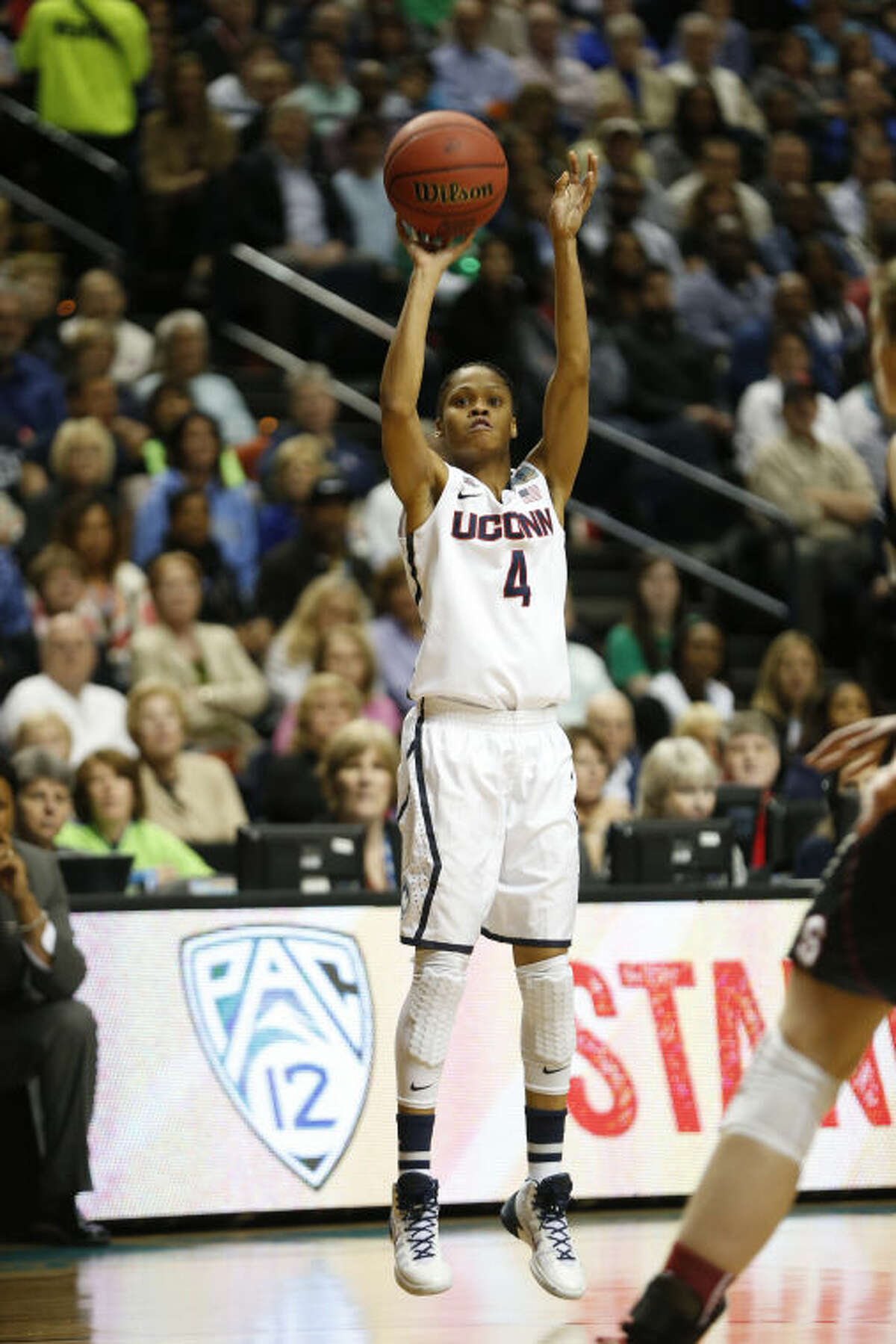 Connecticut guard Moriah Jefferson (4) shoots against Stanford during the first half of the semifinal game in the Final Four of the NCAA women's college basketball tournament, Sunday, April 6, 2014, in Nashville, Tenn. (AP Photo/Mark Humphrey)