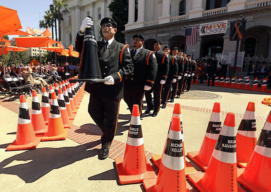 California Department of Transportation Honor Guard member Bill Halterman carries a traffic cone representing highway workers killed on duty during the Caltrans' 25th Annual Workers Memorial ceremony on Thursday, April 16, 2015, at the Capitol in Sacramento, Calif. The ceremony honored highway maintenance workers and other Caltrans employees who were killed on duty since 1921. (AP Photo/Rich Pedroncelli)