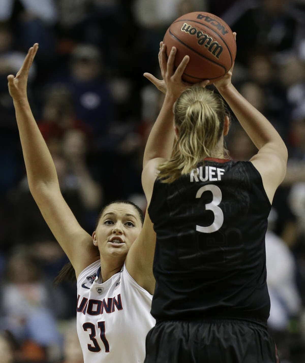 Stanford forward Mikaela Ruef (3) shoots against Connecticut center Stefanie Dolson (31) during the first half of the semifinal game in the Final Four of the NCAA women's college basketball tournament, Sunday, April 6, 2014, in Nashville, Tenn. (AP Photo/Mark Humphrey)