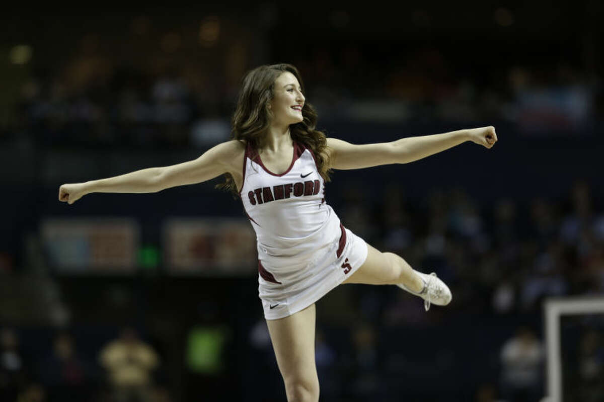 Stanford cheerleaders perform against Connecticut during the first half of the semifinal game in the Final Four of the NCAA women's college basketball tournament, Sunday, April 6, 2014, in Nashville, Tenn. (AP Photo/Mark Humphrey)