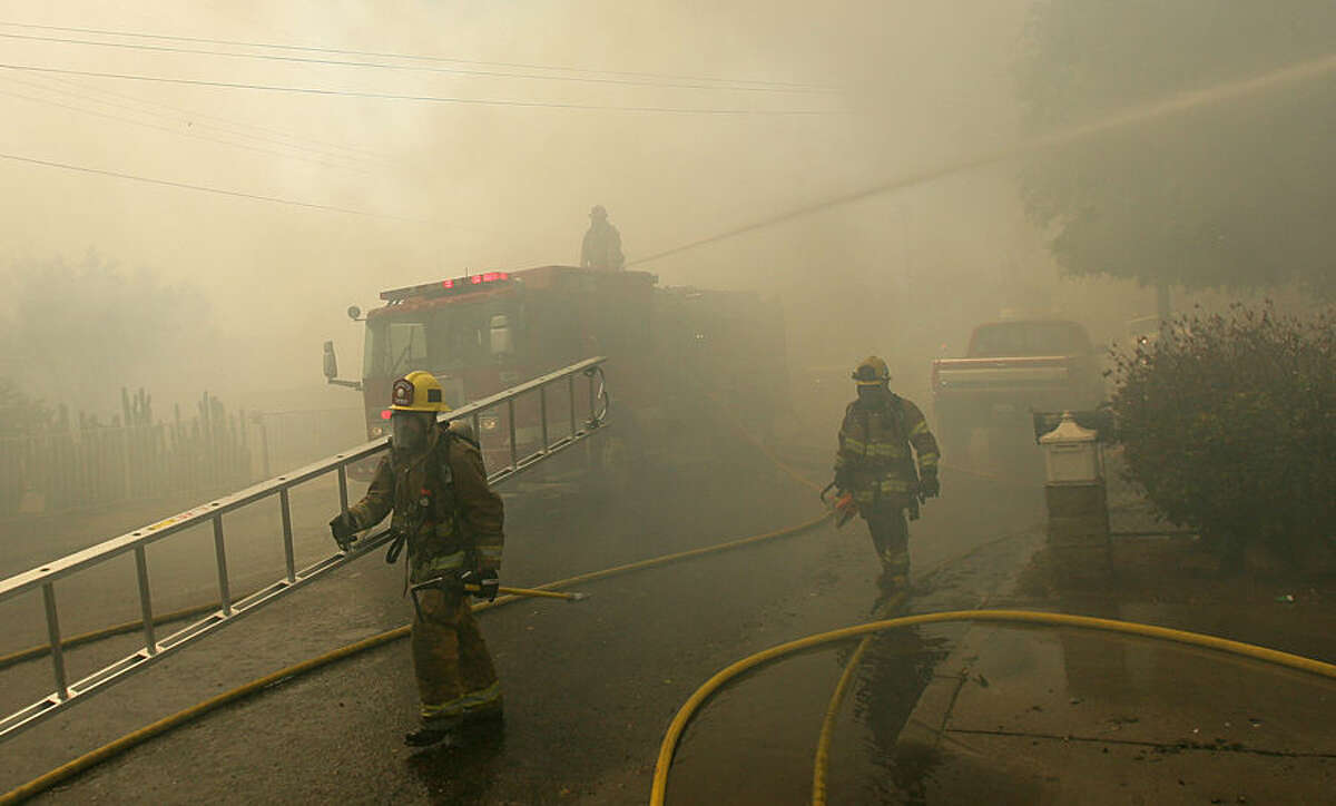Firefighters work to put out a fire at a home in Jurupa Valley, Calif., Thursday, April 16, 2015. Firefighters in Riverside County are battling a blaze that burned a home and prompted evacuations of about 25 others. (Stan Lim/The Press-Enterprise via AP) MAGS OUT; MANDATORY CREDIT; LOS ANGELES TIMES OUT