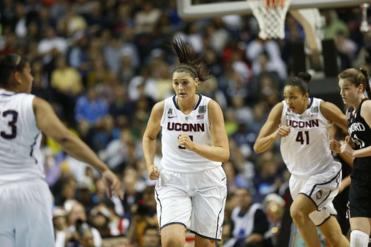 Connecticut center Stefanie Dolson (31) moves up court against Stanford during the first half of the semifinal game in the Final Four of the NCAA women's college basketball tournament, Sunday, April 6, 2014, in Nashville, Tenn. (AP Photo/John Bazemore)