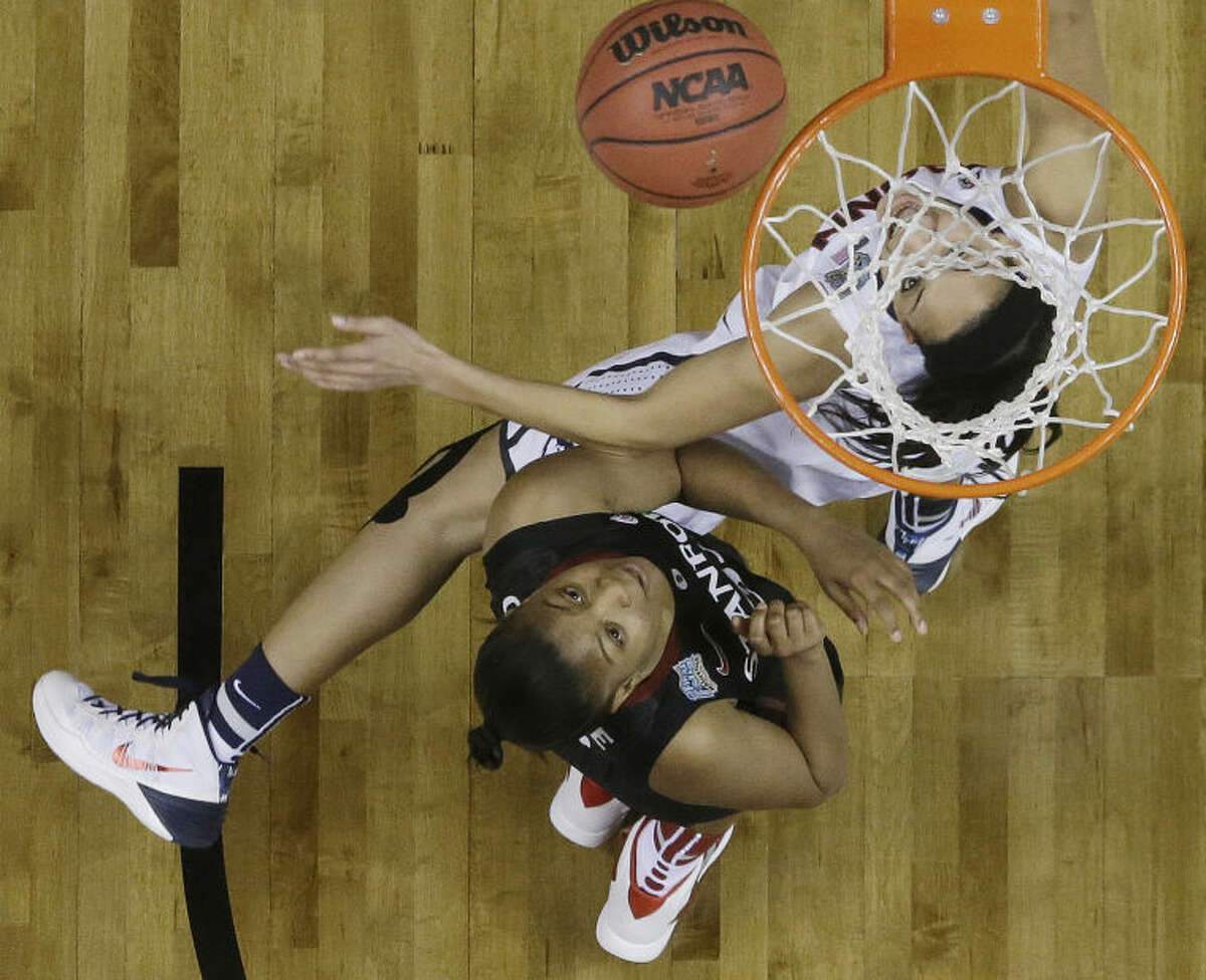 Connecticut guard Bria Hartley (14) shoots against Stanford guard Amber Orrange (33) during the second half of the semifinal game in the Final Four of the NCAA women's college basketball tournament, Sunday, April 6, 2014, in Nashville, Tenn. (AP Photo/Mark Humphrey)