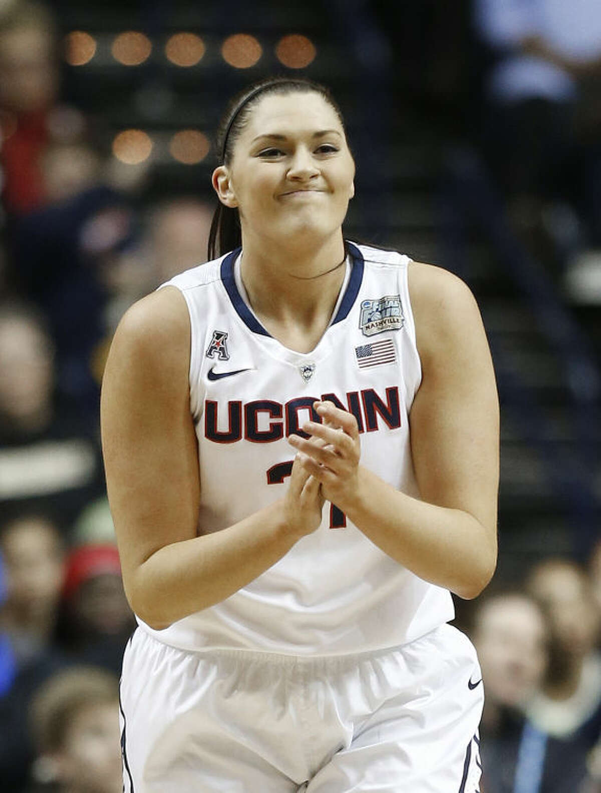 Connecticut center Stefanie Dolson (31) celebrates a basket against Stanford during the first half of the semifinal game in the Final Four of the NCAA women's college basketball tournament, Sunday, April 6, 2014, in Nashville, Tenn. (AP Photo/John Bazemore)