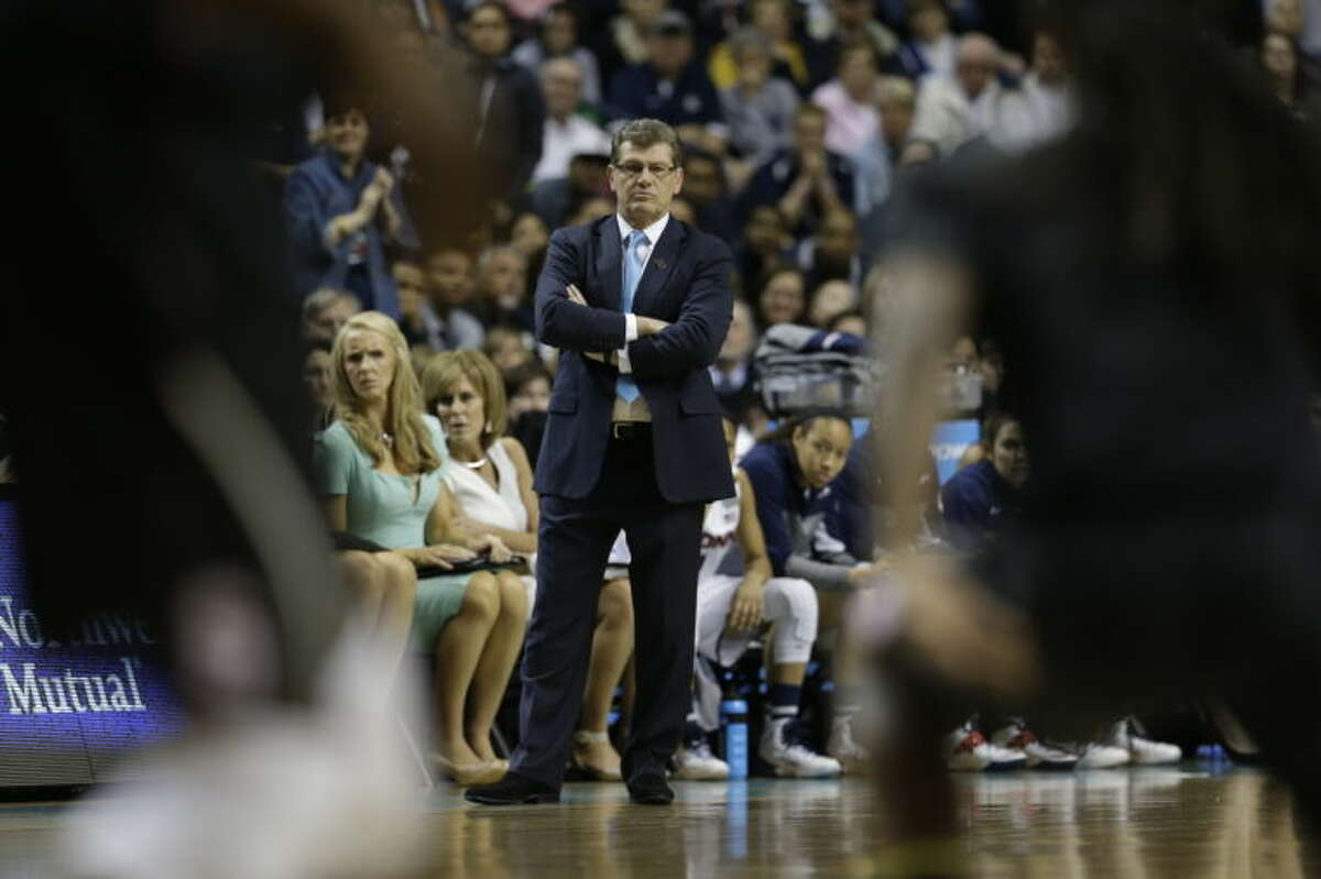 Connecticut head coach Geno Auriemma watches play against Stanford during the first half of the semifinal game in the Final Four of the NCAA women's college basketball tournament, Sunday, April 6, 2014, in Nashville, Tenn. (AP Photo/Mark Humphrey)