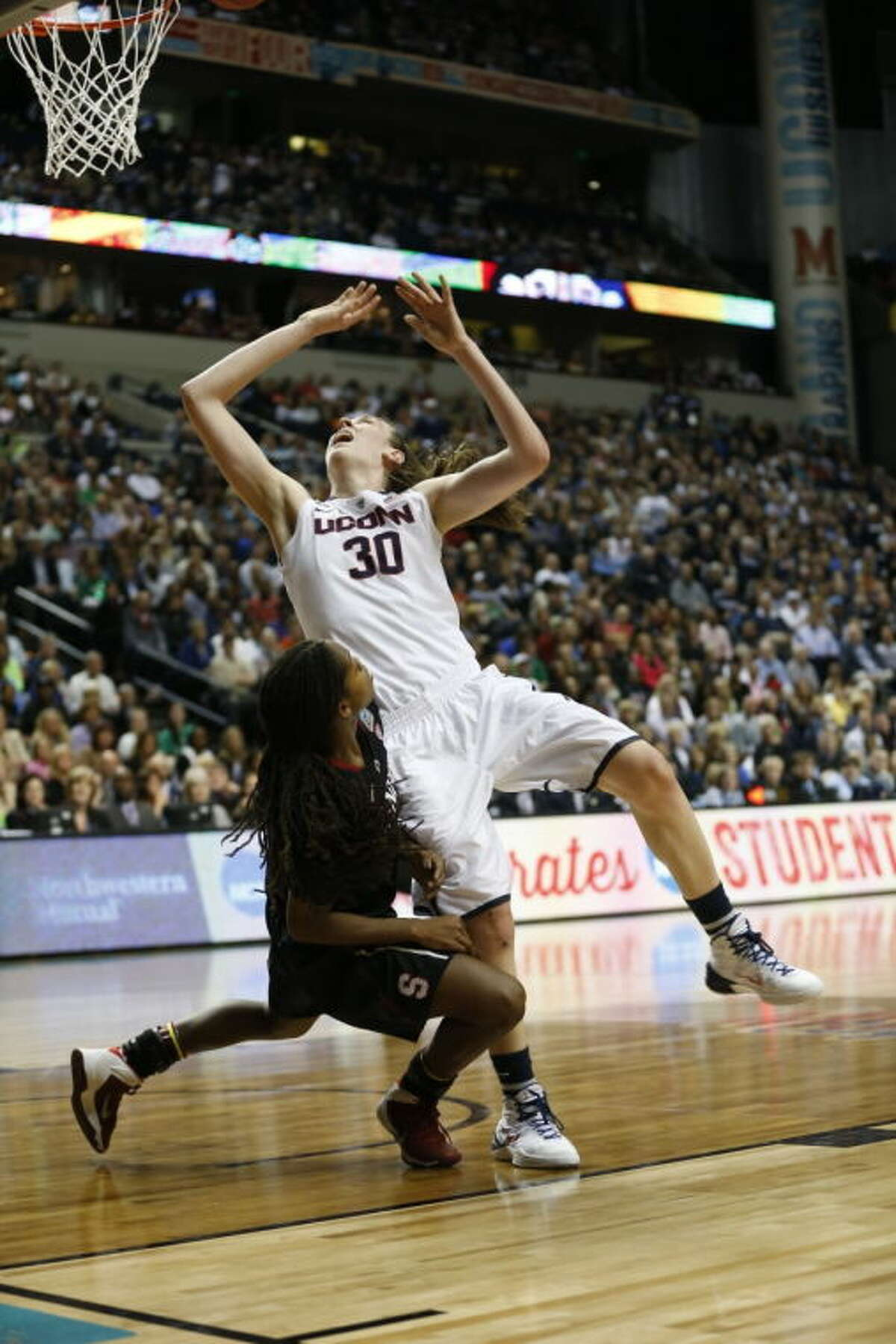 Connecticut forward Breanna Stewart (30) shoots over Stanford guard Lili Thompson (1) during the first half of the semifinal game in the Final Four of the NCAA women's college basketball tournament, Sunday, April 6, 2014, in Nashville, Tenn. (AP Photo/Mark Humphrey)
