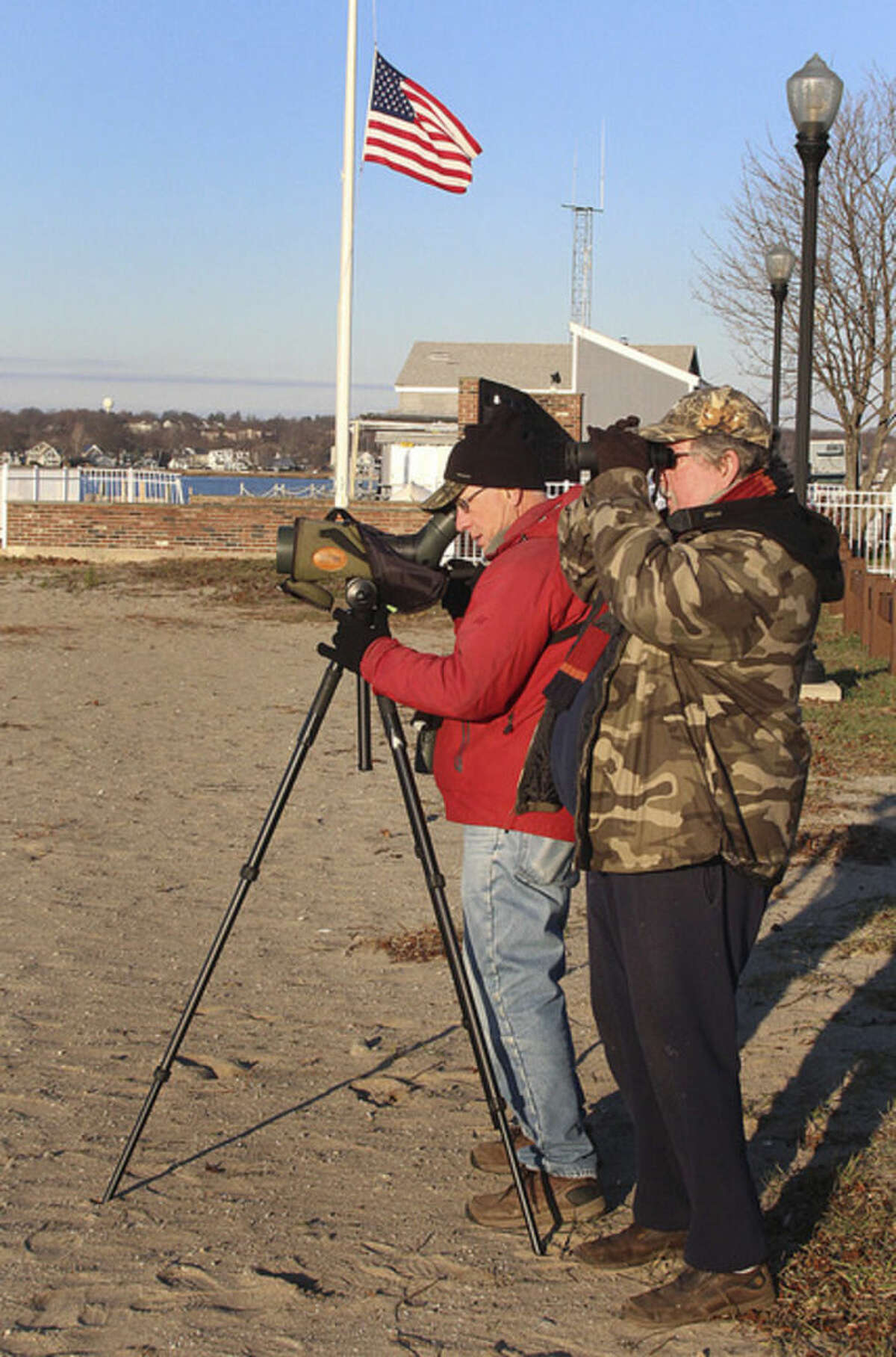 Hour photo/Chris Bosak Birdwatchers Frank Mantlik and Larry Flynn scan Long Island Sound for birds from Calf Pasture Beach on Sunday during the annual Christmas Bird Count.