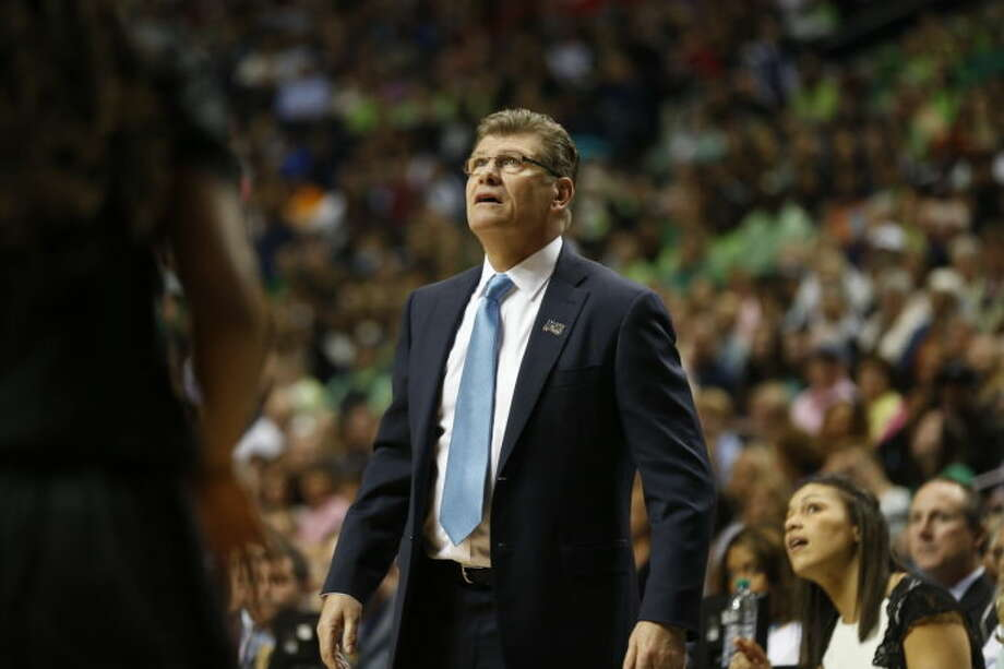 Connecticut head coach Geno Auriemma watches a replay against Stanford during the first half of the semifinal game in the Final Four of the NCAA women's college basketball tournament, Sunday, April 6, 2014, in Nashville, Tenn. (AP Photo/John Bazemore)