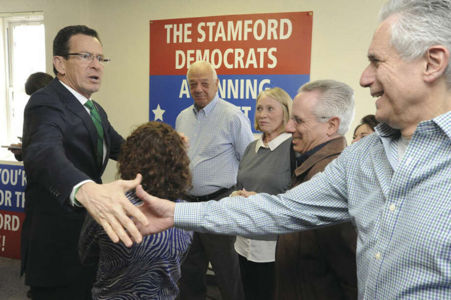 Hour photo / Matthew VinciGov. Dannel Malloy greets Mike Yantorno Sunday at the Malloy campaign open house in Stamford.