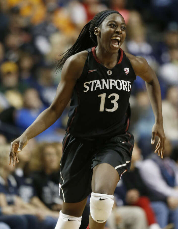 Stanford forward Chiney Ogwumike (13) celebrates a basket against Connecticut during the second half of the semifinal game in the Final Four of the NCAA women's college basketball tournament, Sunday, April 6, 2014, in Nashville, Tenn. (AP Photo/John Bazemore)