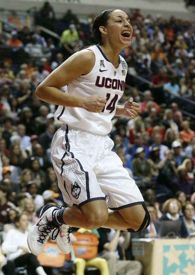 Connecticut guard Bria Hartley (14) celebrates her basket against Stanford during the second half of the semifinal game in the Final Four of the NCAA women's college basketball tournament, Sunday, April 6, 2014, in Nashville, Tenn. (AP Photo/John Bazemore)