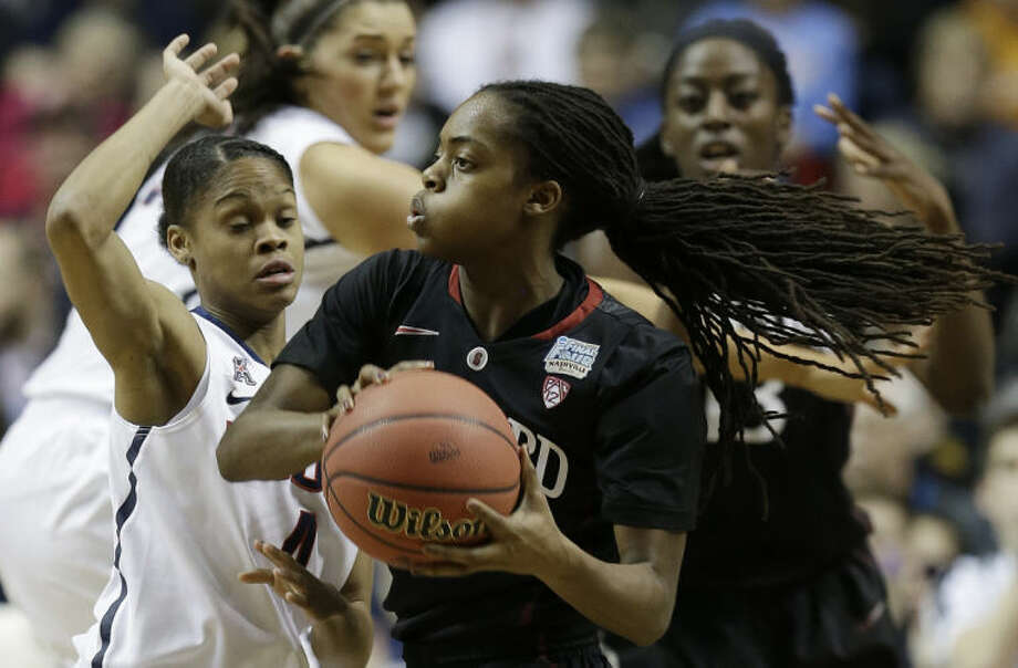 Connecticut guard Moriah Jefferson (4) defends Stanford guard Lili Thompson (1) during the first half of the semifinal game in the Final Four of the NCAA women's college basketball tournament, Sunday, April 6, 2014, in Nashville, Tenn. (AP Photo/Mark Humphrey)