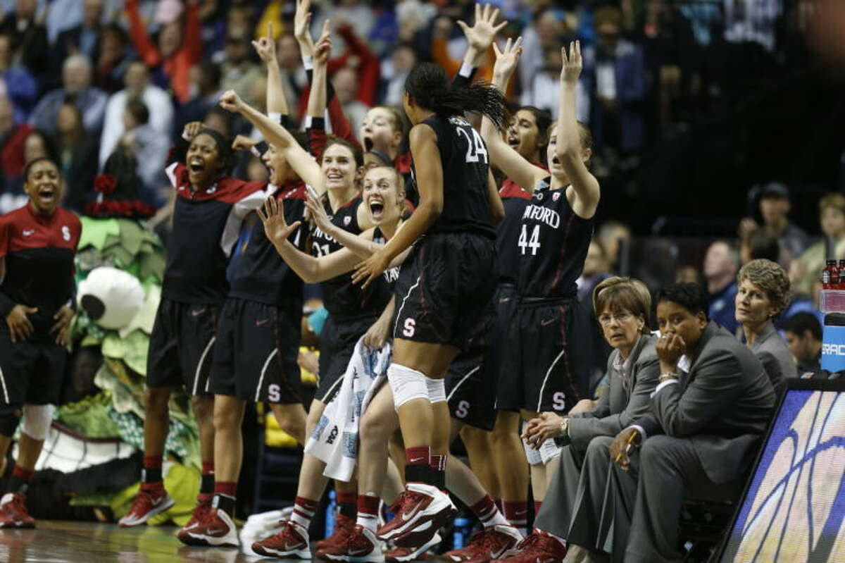 Stanford players cheer against Connecticut during the first half of the semifinal game in the Final Four of the NCAA women's college basketball tournament, Sunday, April 6, 2014, in Nashville, Tenn. (AP Photo/John Bazemore)