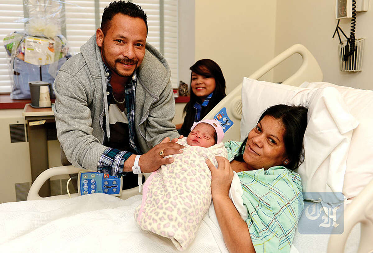 Hour photo / Erik Trautmann Dimas Amaya, Dawn Ayama-Rodriguez and Nora Rodriguez celebrate the birth of a new addition to their family, Ella Amaya-Rodriguez, who was the first baby born in Norwalk this year.