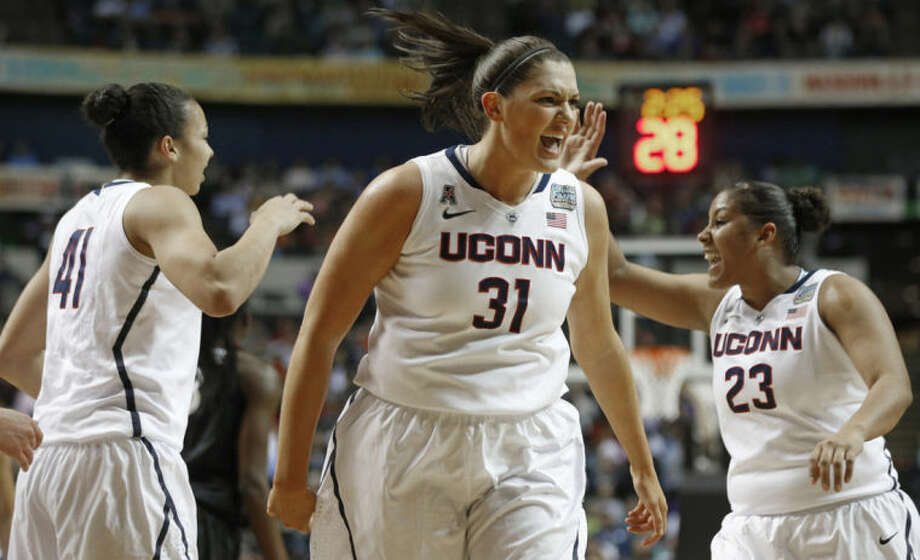 Connecticut center Stefanie Dolson (31) celebrates against Stanford during the first half of the semifinal game in the Final Four of the NCAA women's college basketball tournament, Sunday, April 6, 2014, in Nashville, Tenn. (AP Photo/John Bazemore)