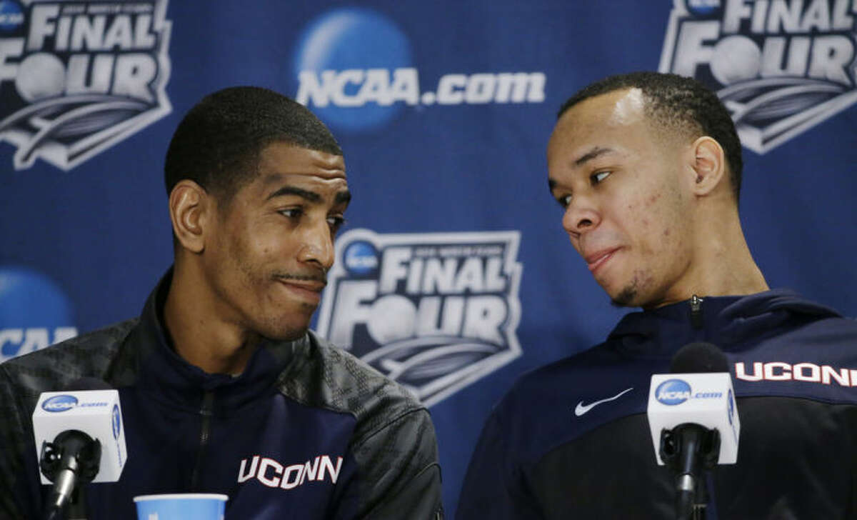 Connecticut forward Kentan Facey, left, and guard Shabazz Napier chat with each other during a news conference for the NCAA Final Four tournament college basketball championship game Sunday, April 6, 2014, in Arlington, Texas. Connecticut plays Kentucky in the championship game on Monday, April 7. 2014. (AP Photo/David J. Phillip)
