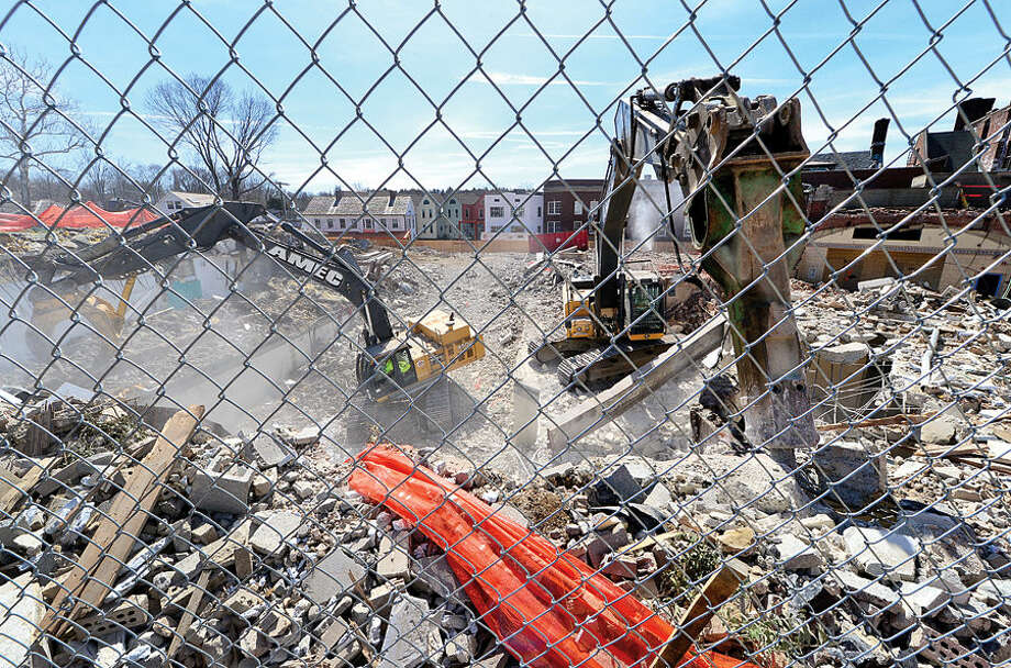 Hour photo / Erik Trautmann The old YMCA building in downtown Westport is being partially torn down and the old Bedford building restored in preparation for Bedford Square Associates' 60,000-square-foot development that includes retail, residential, restaurant and office space.
