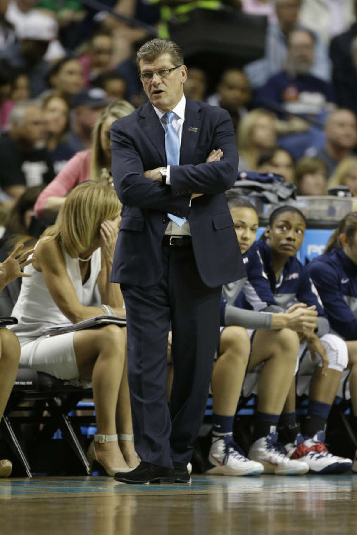 Connecticut head coach Geno Auriemma walks the court against Stanford during the first half of the semifinal game in the Final Four of the NCAA women's college basketball tournament, Sunday, April 6, 2014, in Nashville, Tenn. (AP Photo/Mark Humphrey)