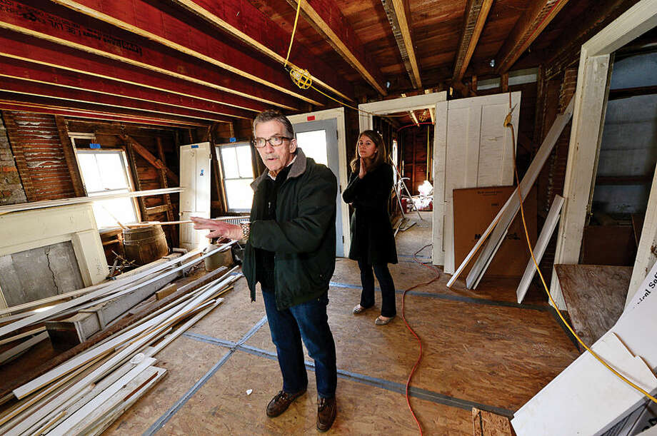 President of the Friends of Ambler Farm, Neil Gluckin, and Ambler Farm administrative coordinator, Robin Clune, give a tour of the Raymond-Ambler Farmhouse to show some of proposed renovations planned for the historic building.