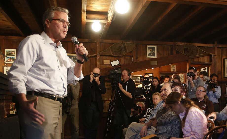 """Former Florida Gov. Jeb Bush speaks to a group at a Politics and Pie at the Snow Shoe Club Thursday, April 16, 2015, in Concord, N.H. Bush said Thursday he will make up his mind """"in relatively short order"""" whether to seek the Republican nomination for president in 2016. (AP Photo/Jim Cole)"""