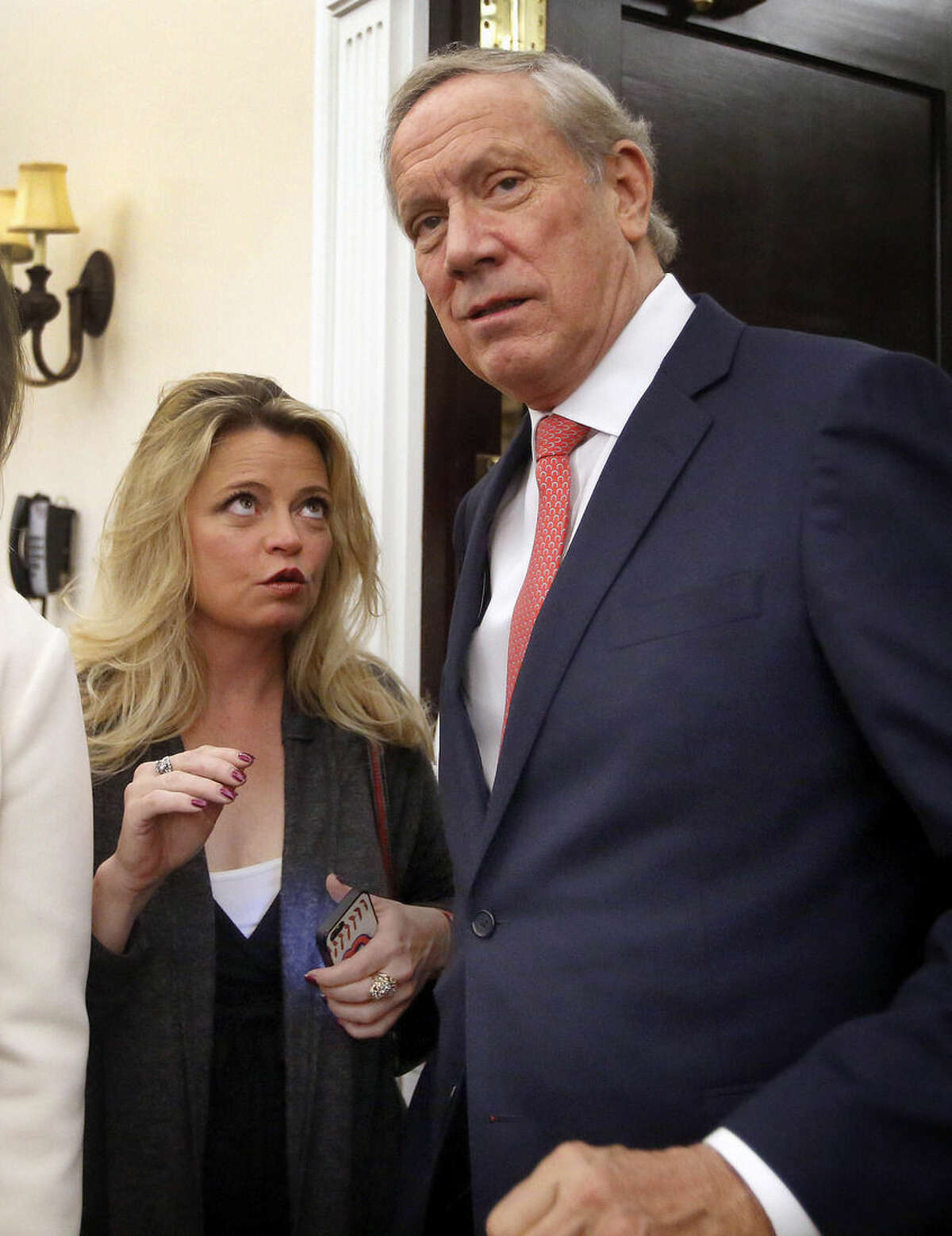 Former Gov. New York George Pataki listens to his aide Alicia Preston as he arrives at the Republican Leadership Summit, Friday, April 17, 2015, in Nashua, N.H. (AP Photo/Jim Cole)