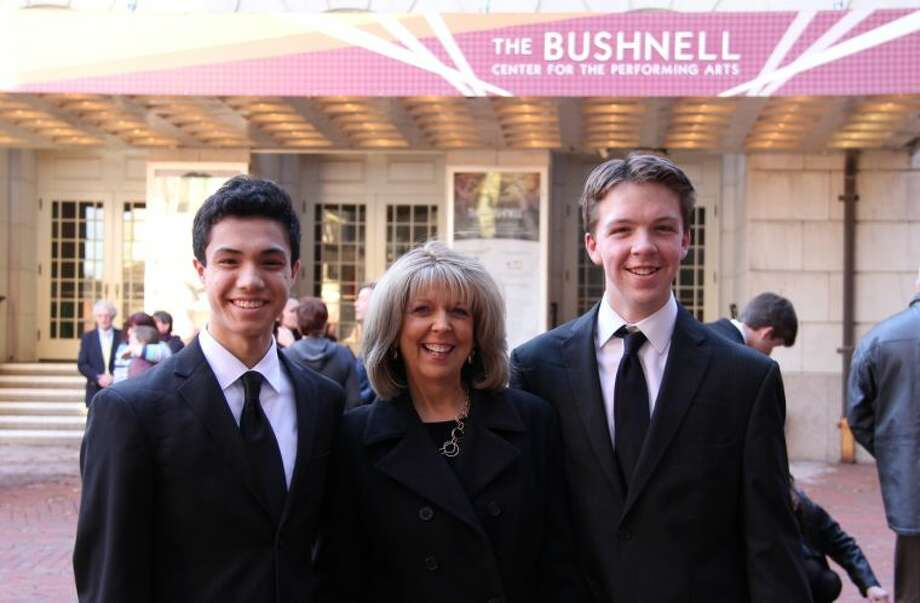 Chase Smith and Griffin King at the Bushnell Theatre with Betsey de Groff, their Choir Director at Wilton High School.