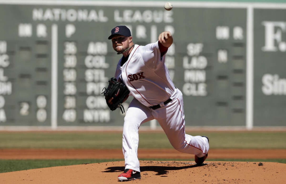 Boston Red Sox's Jon Lester delivers a pitch against the Milwaukee Brewers in the first inning of a baseball game Sunday, April 6, 2014, in Boston. (AP Photo/Steven Senne)