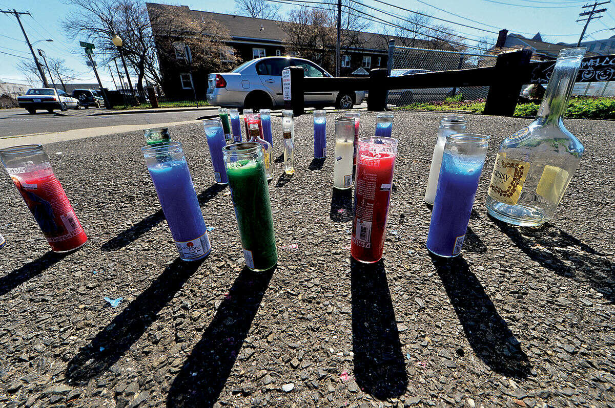 Wednesday night, April 14, 2016, as mourners gathered around a makeshift memorial for 2008 stabbing victim Vontrell George at the edge of Ryan Park, shots were fired near Park and Washington Vilage Housing Complex.
