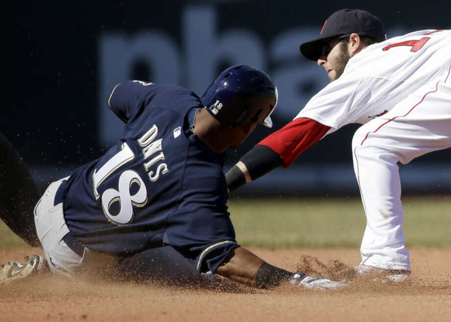 Milwaukee Brewers' Khris Davis (18) slides safe at second base on a double hit as Boston Red Sox's Dustin Pedroia tries to tag him out in the seventh inning of a baseball game Sunday, April 6, 2014, in Boston. (AP Photo/Steven Senne)