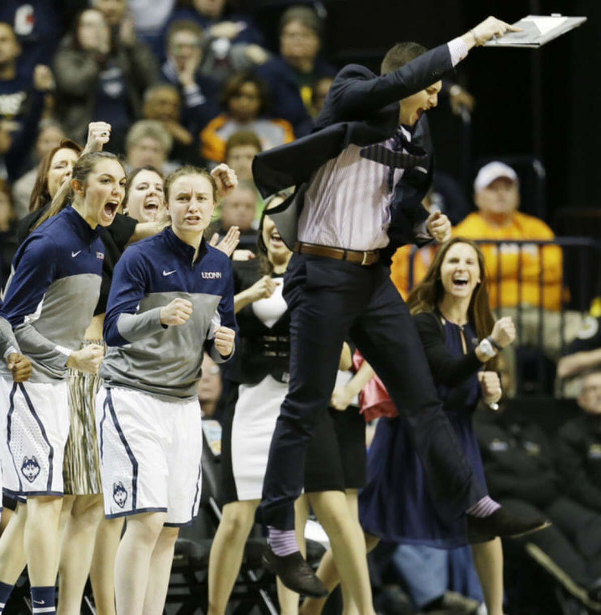 The Connecticut bench celebrates a basket against Stanford during the first half of the semifinal game in the Final Four of the NCAA women's college basketball tournament, Sunday, April 6, 2014, in Nashville, Tenn. (AP Photo/Mark Humphrey)