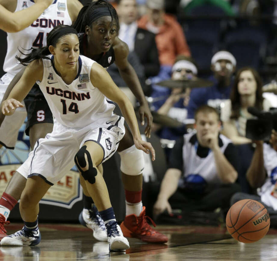 Connecticut guard Bria Hartley (14) and Stanford forward Chiney Ogwumike (13) vie for a loose ball during the first half of the semifinal game in the Final Four of the NCAA women's college basketball tournament, Sunday, April 6, 2014, in Nashville, Tenn. (AP Photo/Mark Humphrey)