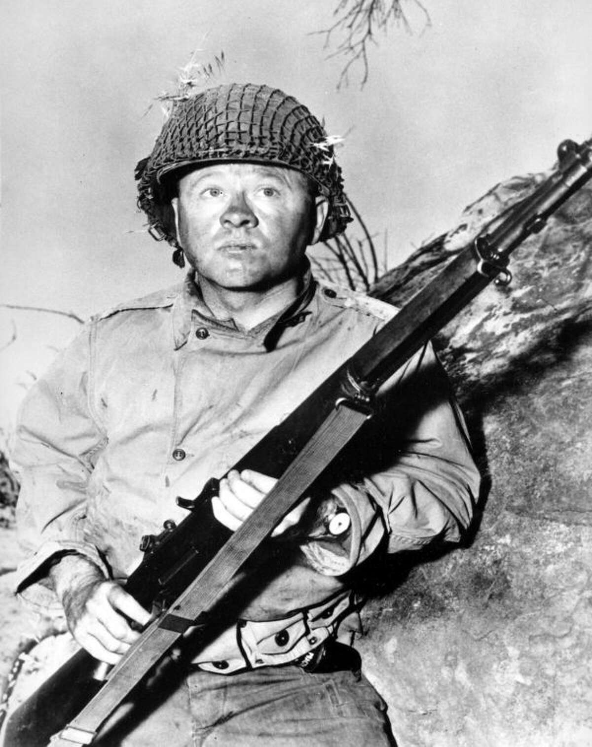 """FILE - Actor Mickey Rooney is shown in this file photo as G.I. Dooley in the 1956 Hollywood movie """"The Bold and the Brave."""" Rooney, a Hollywood legend whose career spanned more than 80 years, has died. He was 93. Los Angeles Police Commander Andrew Smith said that Rooney was with his family when he died Sunday, April 6, 2014, at his North Hollywood home. (AP Photo/File)"""