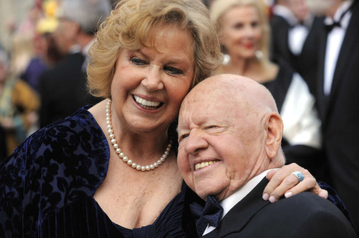 FILE - In this Sunday, March 7, 2010, file photo, Mickey Rooney, right, and Jane Rooney arrive during the 82nd Academy Awards, in the Hollywood section of Los Angeles. Rooney, a Hollywood legend whose career spanned more than 80 years, has died. He was 93. Los Angeles Police Commander Andrew Smith said that Rooney was with his family when he died Sunday, April 6, 2014, at his North Hollywood home. (AP Photo/Chris Pizzello, File)