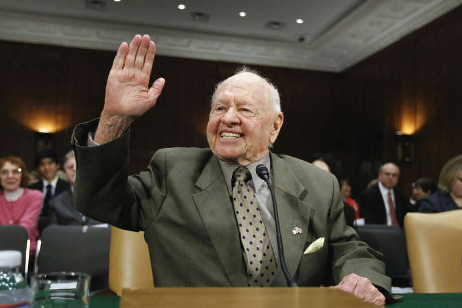 FILE - In this Wednesday, March 2, 2011, file photo, entertainer Mickey Rooney waves on Capitol Hill in Washington, prior to testifying about elder abuse, before the Senate Aging Committee. Rooney, a Hollywood legend whose career spanned more than 80 years, has died. He was 93. Los Angeles Police Commander Andrew Smith said that Rooney was with his family when he died Sunday, April 6, 2014, at his North Hollywood home. (AP Photo/Alex Brandon, File)